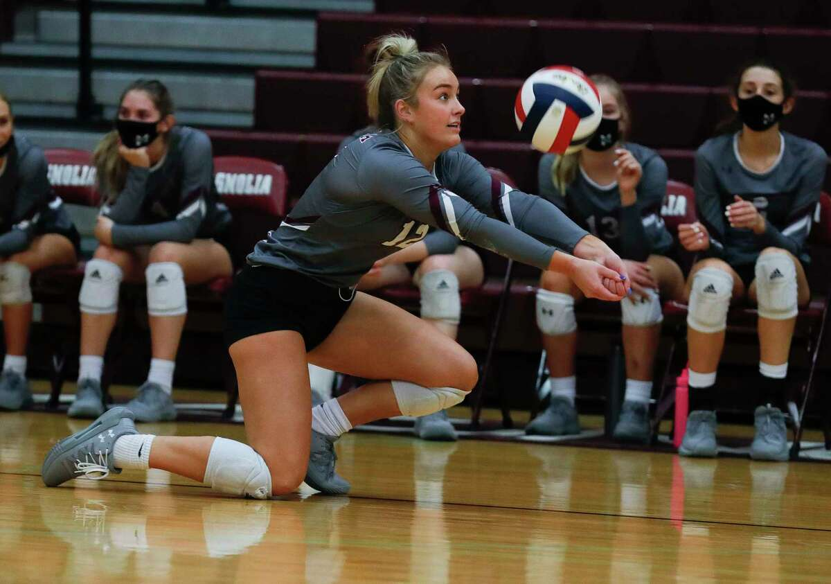 Magnolia outside hitter Sydney Gentry (12) returns a hit during the first set of a District 19-5A high school volleyball match at Magnolia High School, Tuesday, Nov. 10, 2020, in Magnolia.