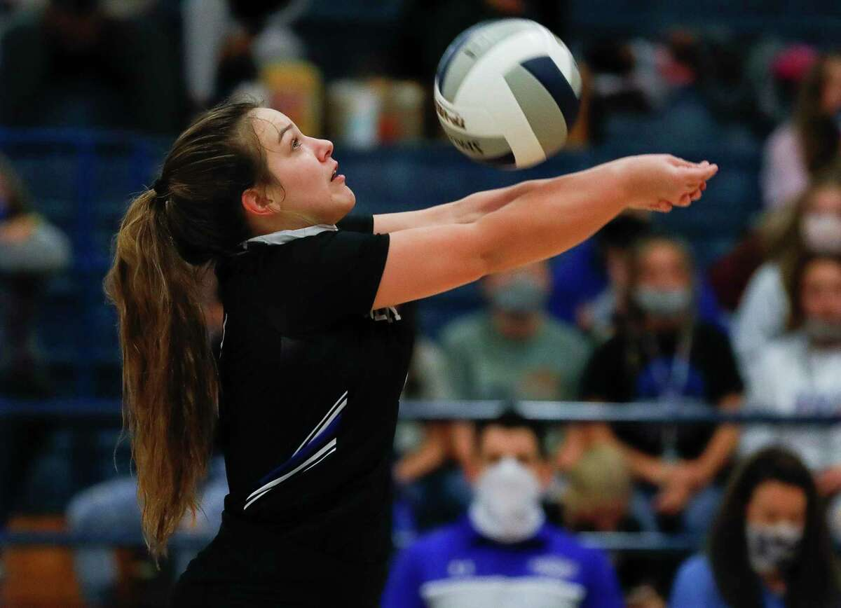 New Caney setter Kylie Collier (4) returns a hit during the first set of a district 20-5A high school volleyball match at New Caney High School, Tuesday, Nov. 3, 2020, in New Caney.