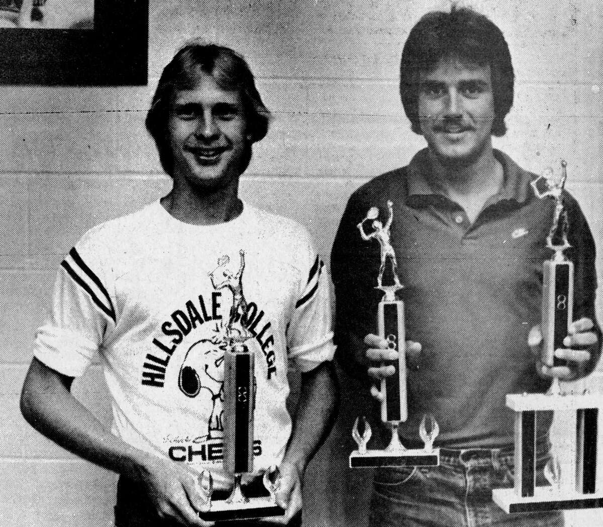 (From left) Scott Solberg and Mark Mrozik teamed up to win the double division of the Manistee Recreation Association Closed County Tennis Tournament. Mrozik also won the singles championship. The photo was published in the News Advocate on July 31, 1981. (Manistee County Historical Museum photo)