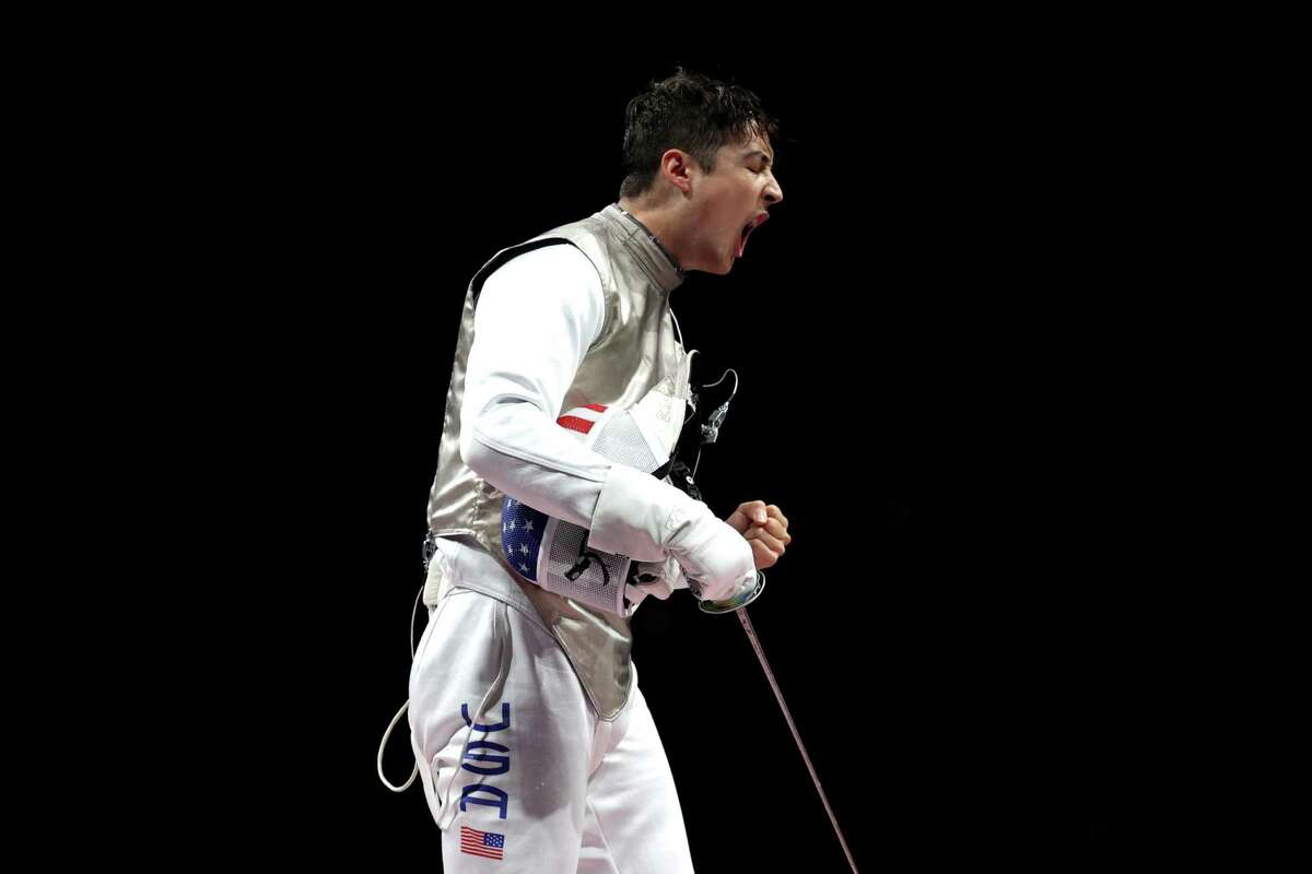 CHIBA, JAPAN - AUGUST 01: Alexander Massialas of Team United States celebrates a point during the Men's Foil Team Fencing Bronze Medal Match against Takahiro Shikine of Team Japan on day nine of the Tokyo 2020 Olympic Games at Makuhari Messe Hall on August 01, 2021 in Chiba, Japan. (Photo by Elsa/Getty Images)