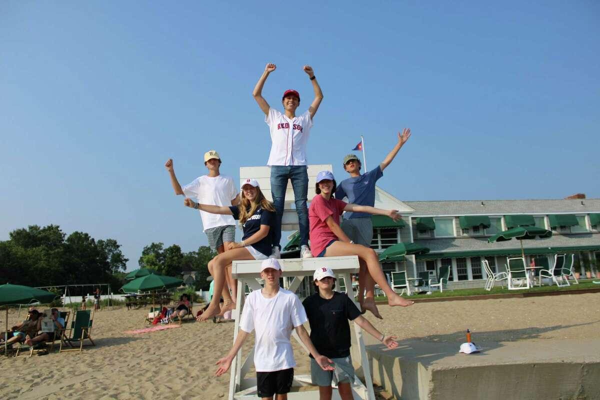 "Rehearsing ""Sweet Caroline"" on the beach, led by Jason Burke (center)."
