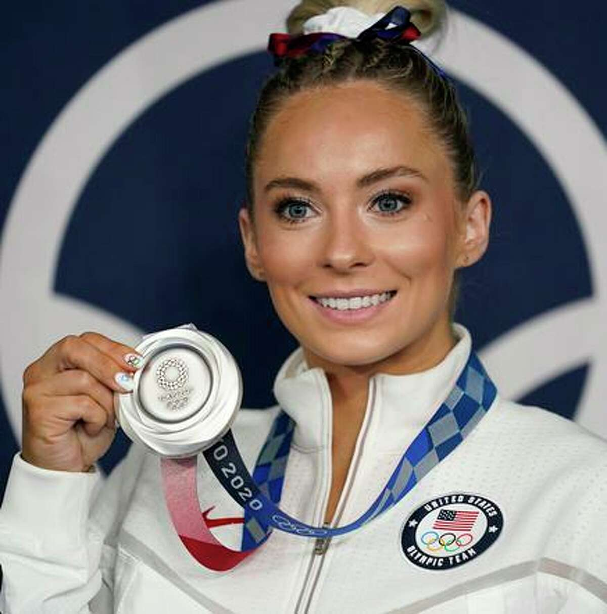 Mykayla Skinner, of United States, poses for a photo with her silver medal for vault after the artistic gymnastics apparatus finals at the 2020 Summer Olympics, Sunday, Aug. 1, 2021, in Tokyo, Japan. (AP Photo/Ashley Landis)