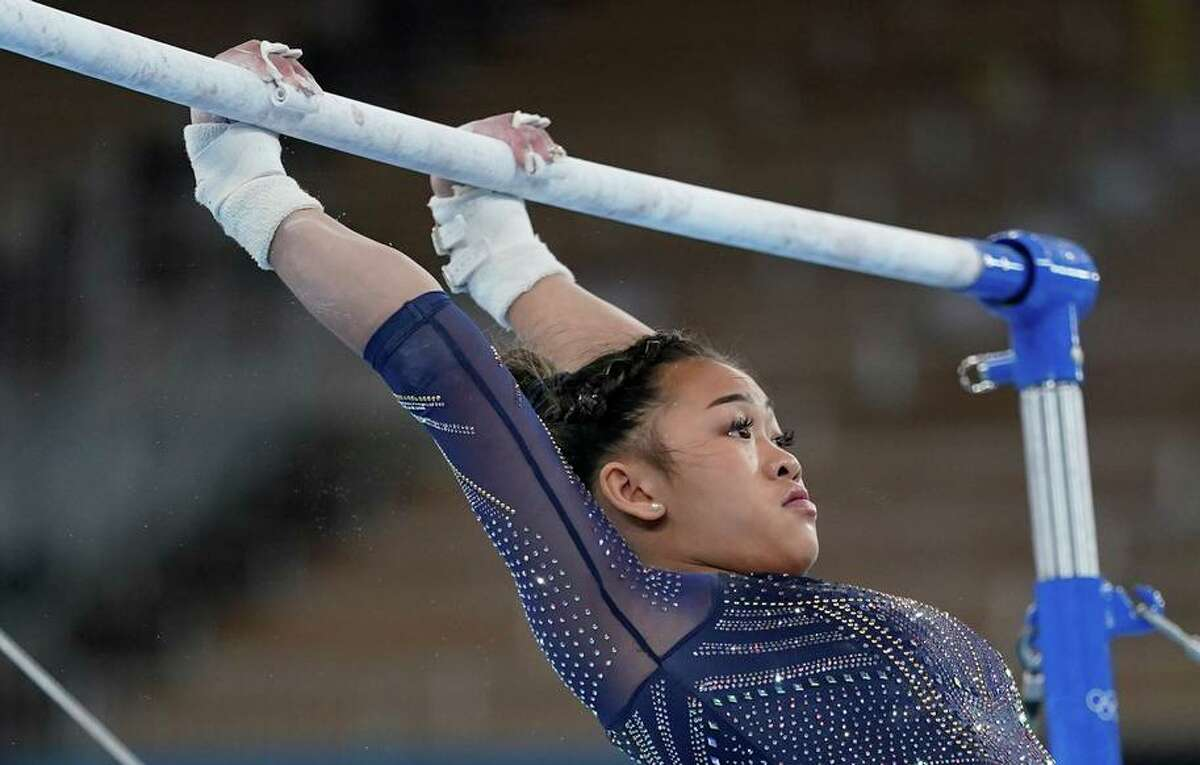 Sunisa Lee of the United States, performs on the uneven bars during the artistic gymnastics women's apparatus final at the 2020 Summer Olympics, Sunday, Aug. 1, 2021, in Tokyo, Japan. (AP Photo/Ashley Landis)