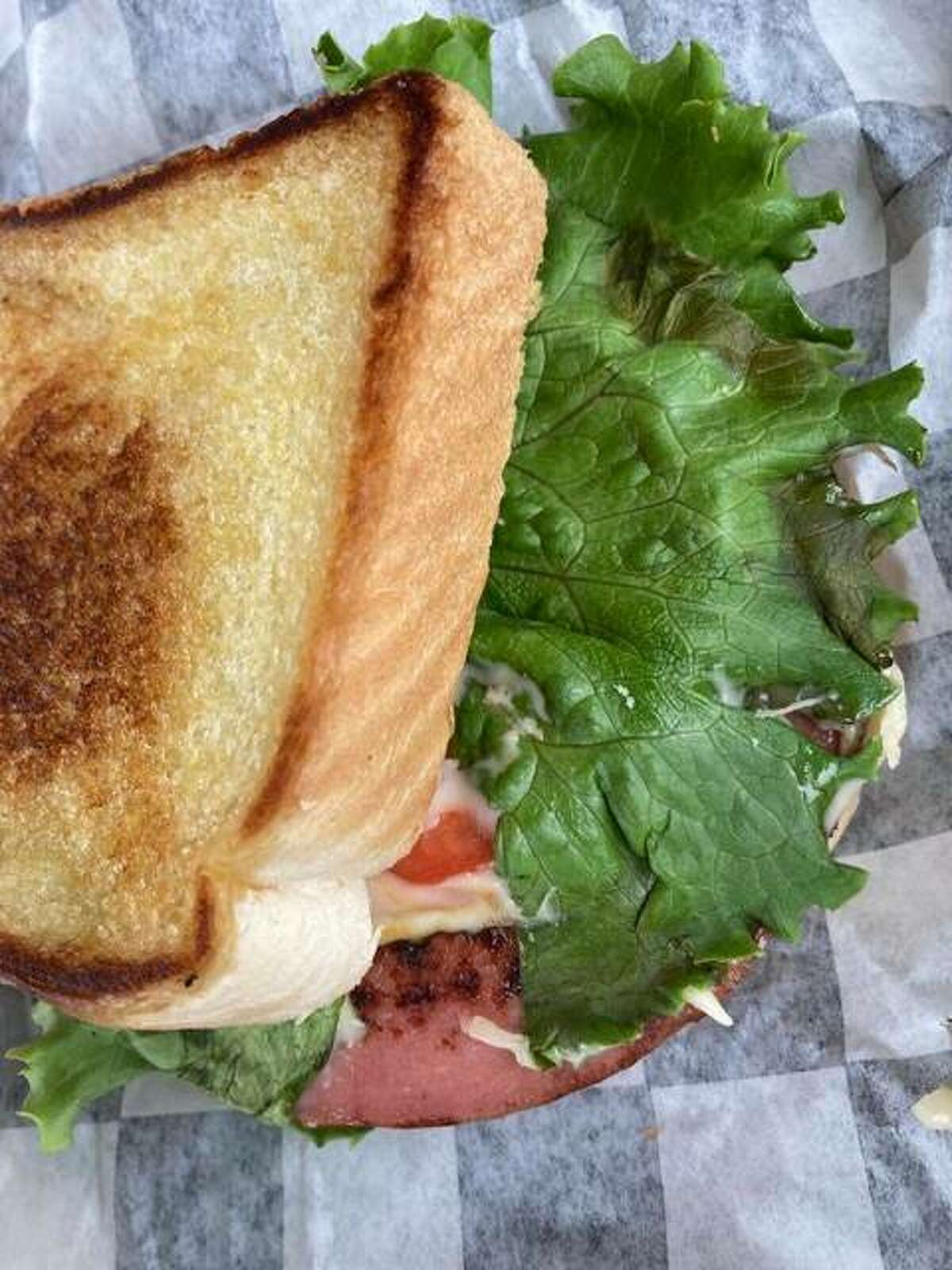The James Dean sandwich, with two slices of Shake Rattle & Roll Drive-In's thick-cut bologna with lettuce, mayo, tomato and pepper jack cheese, toasted to perfection on Texas toast.