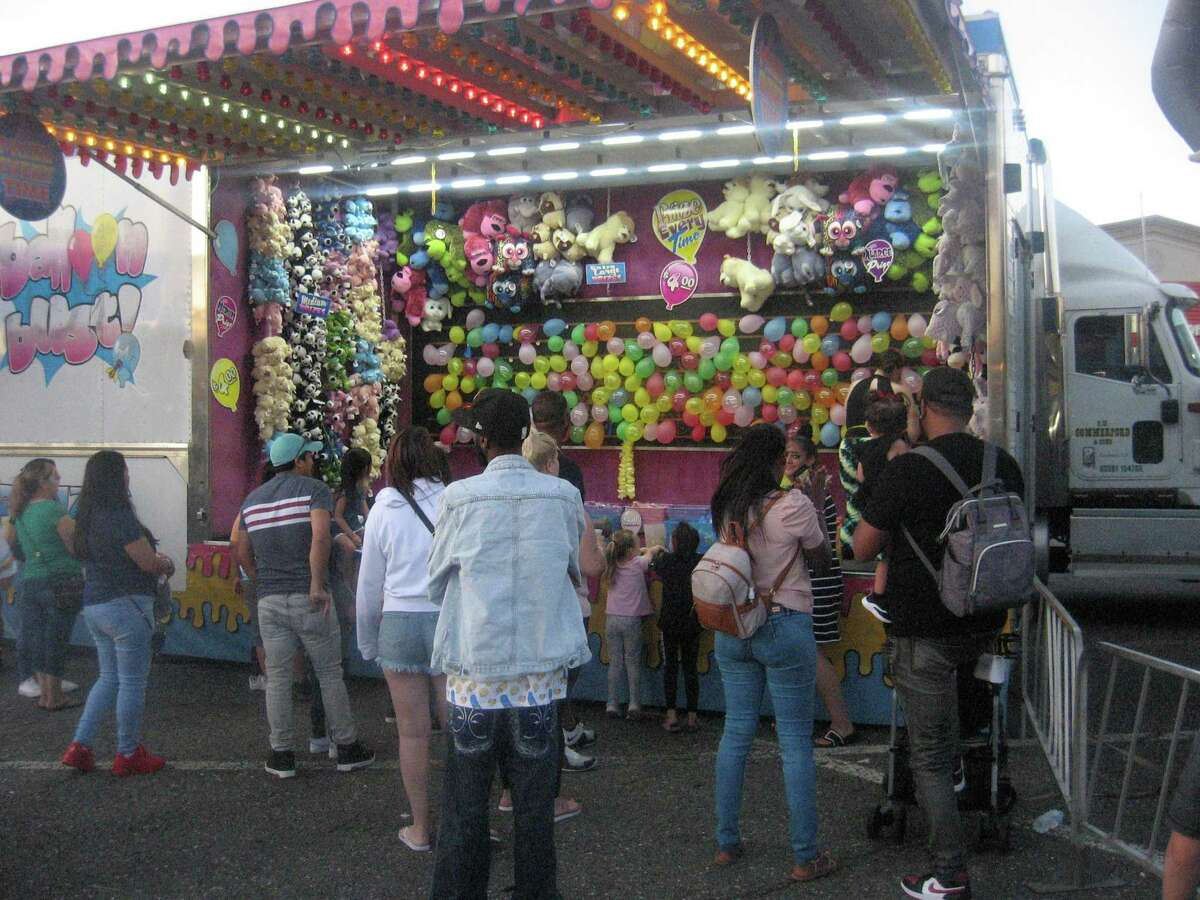 Residents line up for the games of chance at the PAL carnival, held July 30-31 in downtown Torrington.