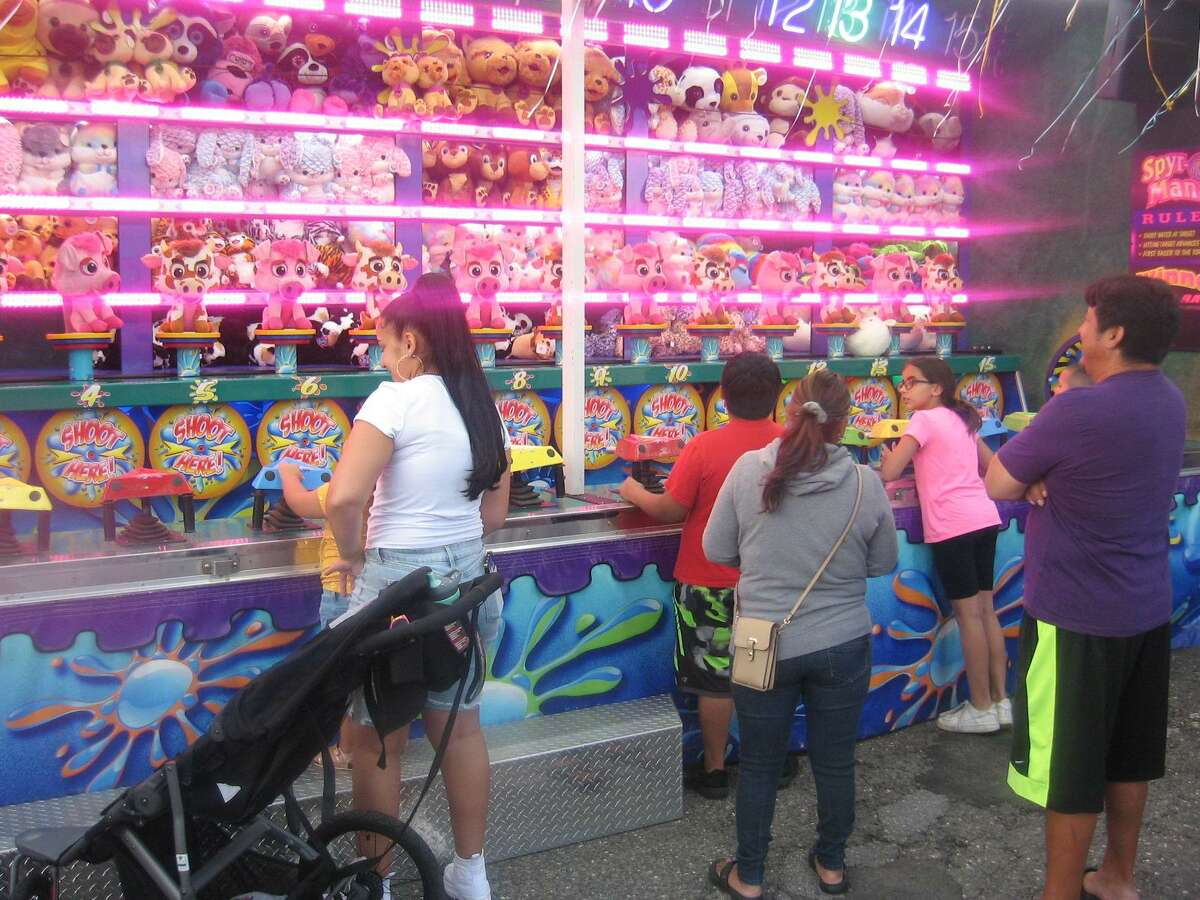 Residents play games at the PAL carnival, held July 30-31 in downtown Torrington.