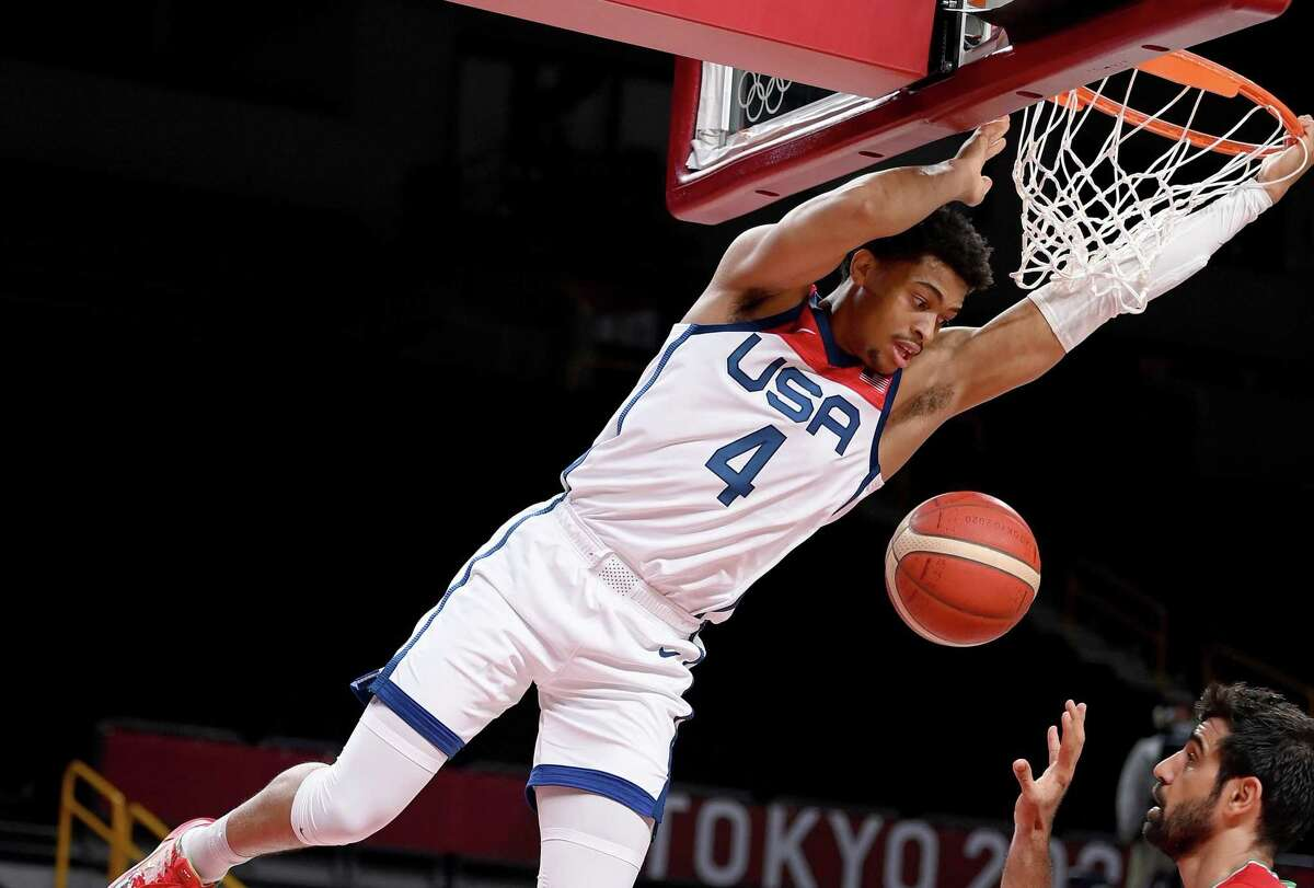 Keldon Johnson #4 of Team United States dunks the ball against Iran during the first half of a Men's Preliminary Round Group A game on day five of the Tokyo 2020 Olympic Games at Saitama Super Arena on July 28, 2021 in Saitama, Japan.