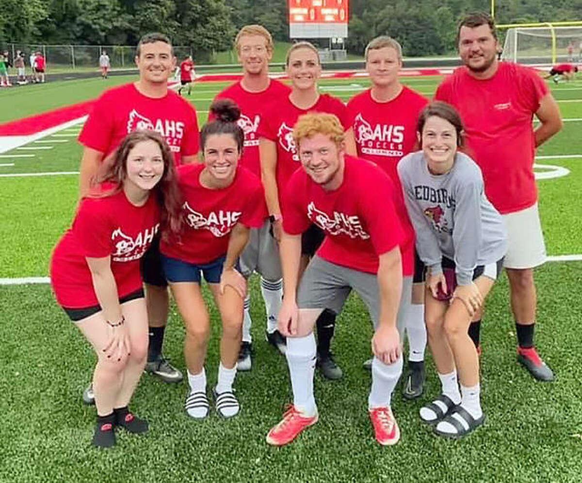 Alton soccer alumni who graduated in 2011 gathered prior to Saturday night's third annual Alton Redbirds Alumni soccer games at Public School Stadium.