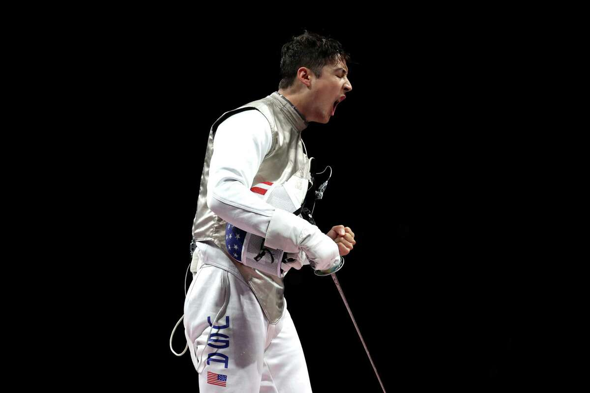 Alexander Massialas celebrates a point during bronze match against Japan in team fencing.
