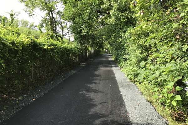 DOT removed and replaced old patches of trail in need of updating due to age and the growth of tree roots, and the entire 2.8 mile stretch was then overlaid with new pavement.
