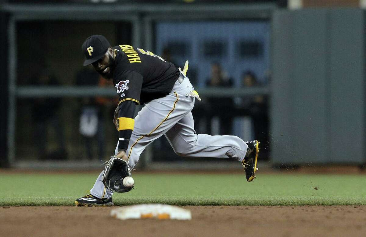 Josh Harrison (5) fields a ball hit by Angel Pagan (16) to end the 2nd inning as the San Francisco Giants played the Pittsburgh Pirates at AT&T Park in San Francisco, Calif., on Monday, August 15, 2016.
