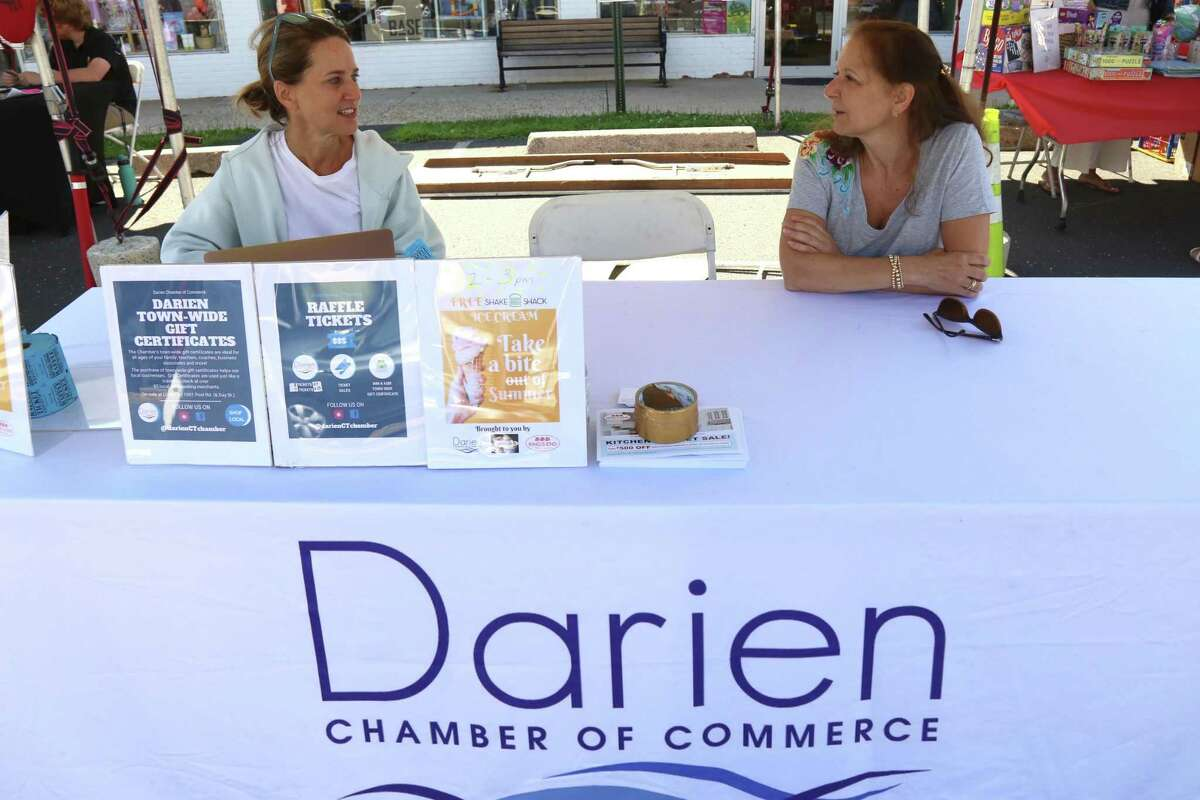 Kesti Aysseh, executive director of the Darien Chamber of Commerce, left, and Michele Gartland, board member, enjoy the last day of the Sidewalk Sales & Family Fun Days event on Saturday, July 31, 2021, in Darien, Conn.