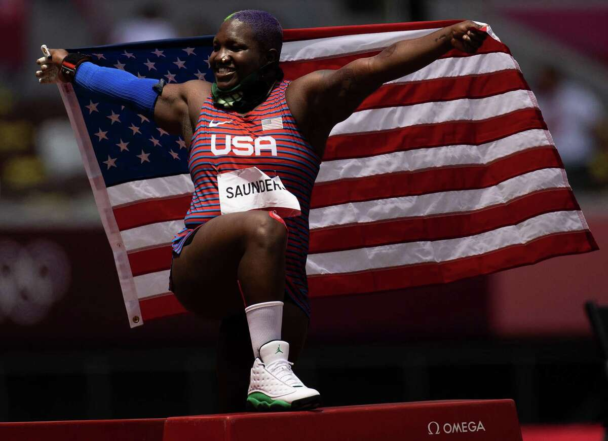 Raven Saunders celebrates with the American flag after winning silver in the shot put.