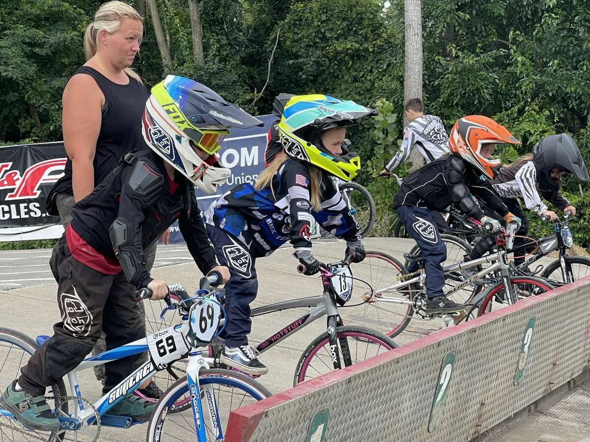 Riders prepare to begin a race at the Gold Cup Championship Series Finals at the Tri-City BMX track in Rotterdam on Sunday, Aug. 1, 2021.