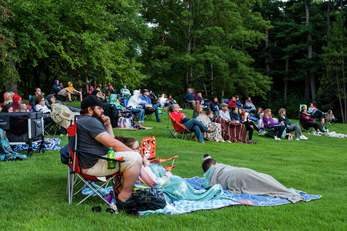 Movie fans watch the big screen during an outdoor screening of Disney's Raya and the Last Dragon Saturday, July 30, 2021 at Dow Gardens. (Adam Ferman/for the Daily News)