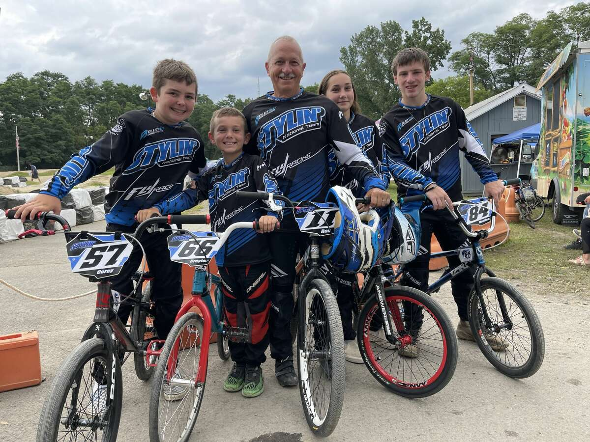 Ron Greene, center, poses with his grandchildren, from left to right: Corey Dutcher, Brayton Buanno, Alyssa Cosselman, and Damien Craig at the Gold Cup Championship Series Finals at the Tri-City BMX track in Rotterdam on Sunday, Aug. 1, 2021.