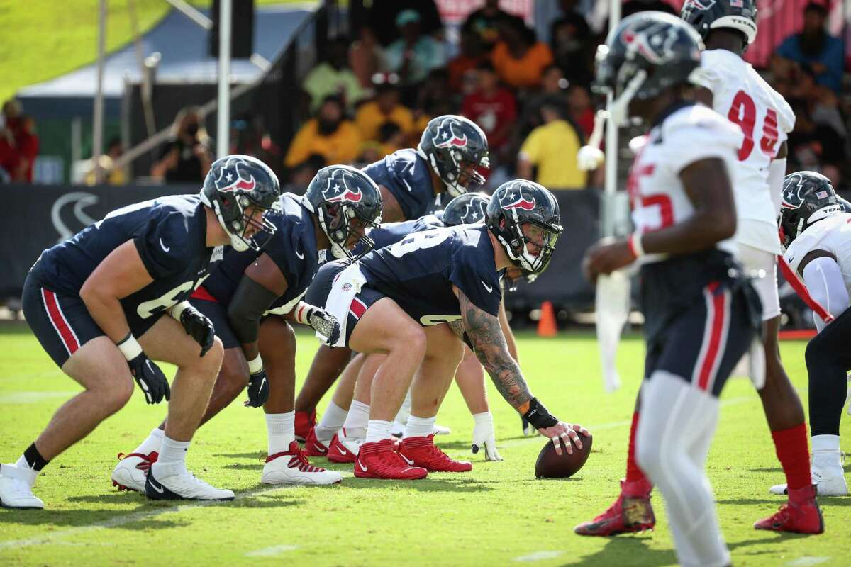 Houston Texans center Justin Britt (68) lines up over the ball with the offensive line during an NFL training camp football practice Saturday, July 31, 2021, in Houston.