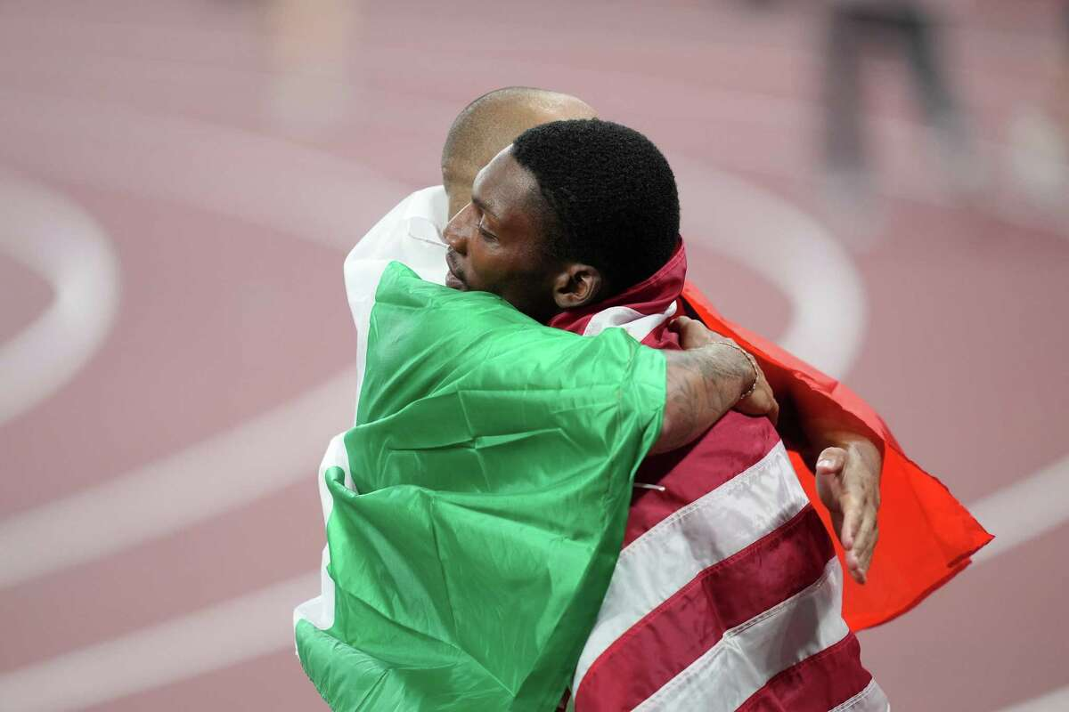 Lamont Marcell Jacobs and Fred Kerley, both with Texas roots, embrace after men's 100 meters.
