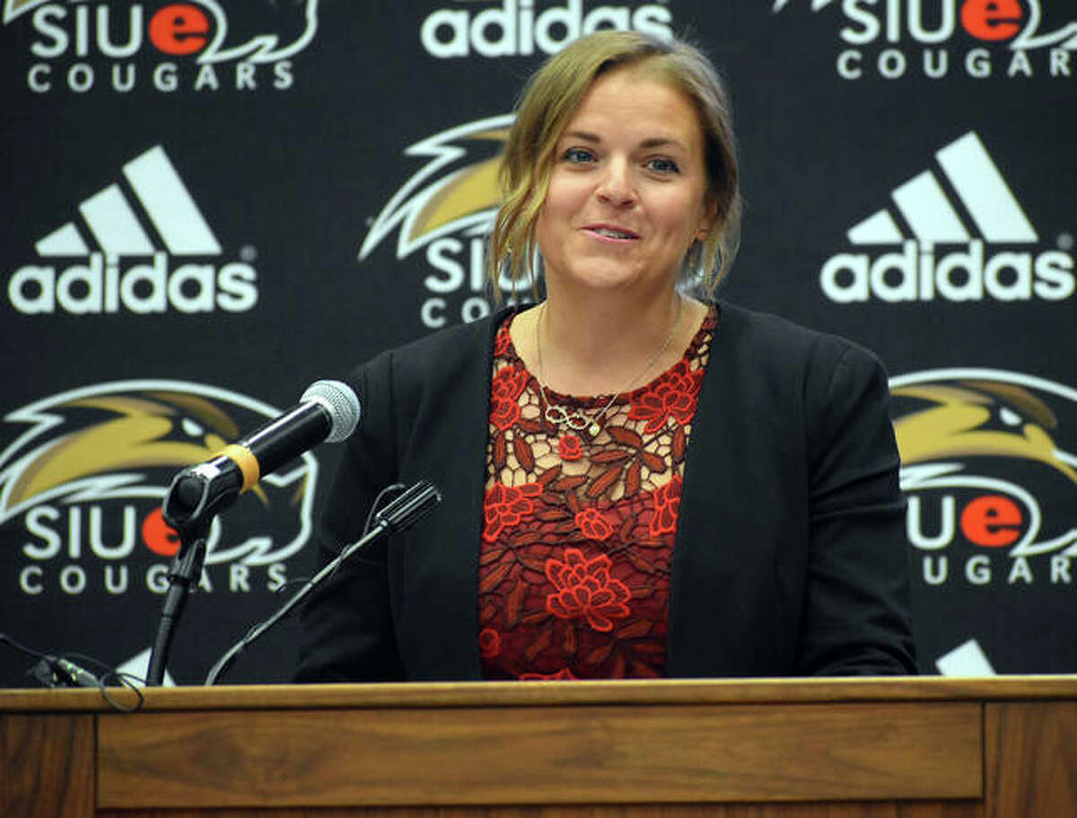 SIUE women's basketball coach Samatha Quigley Smith talks to the crowd during her introduction inside First Community Arena.