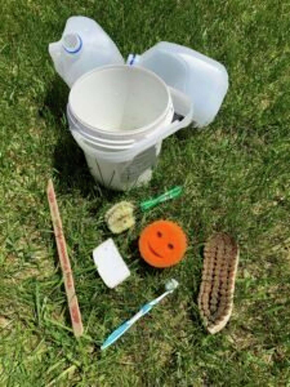"""Participants in a grave cleaning class held by the Benzie Area Historical Society will be asked to bring a grave cleaning """"kit"""" consisting of common household items. (Courtesy Photo)"""
