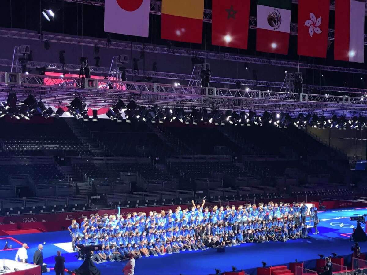 The volunteers at the fencing venue in Chiba gather for a photo on the final night of fencing competition.