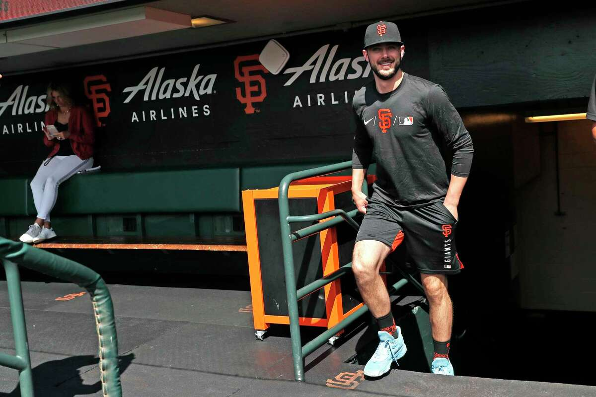 San Francisco Giants' Kris Bryant smiles as he enters the dugout before his first game at Oracle Park in San Francisco, Calif., on Sunday, August 1, 2021.