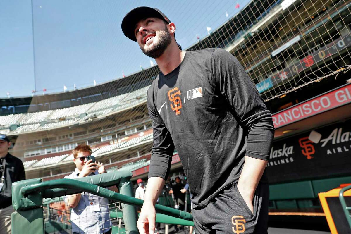San Francisco Giants' Kris Bryant smiles as he walks onto the field before his first game at Oracle Park in San Francisco, Calif., on Sunday, August 1, 2021.