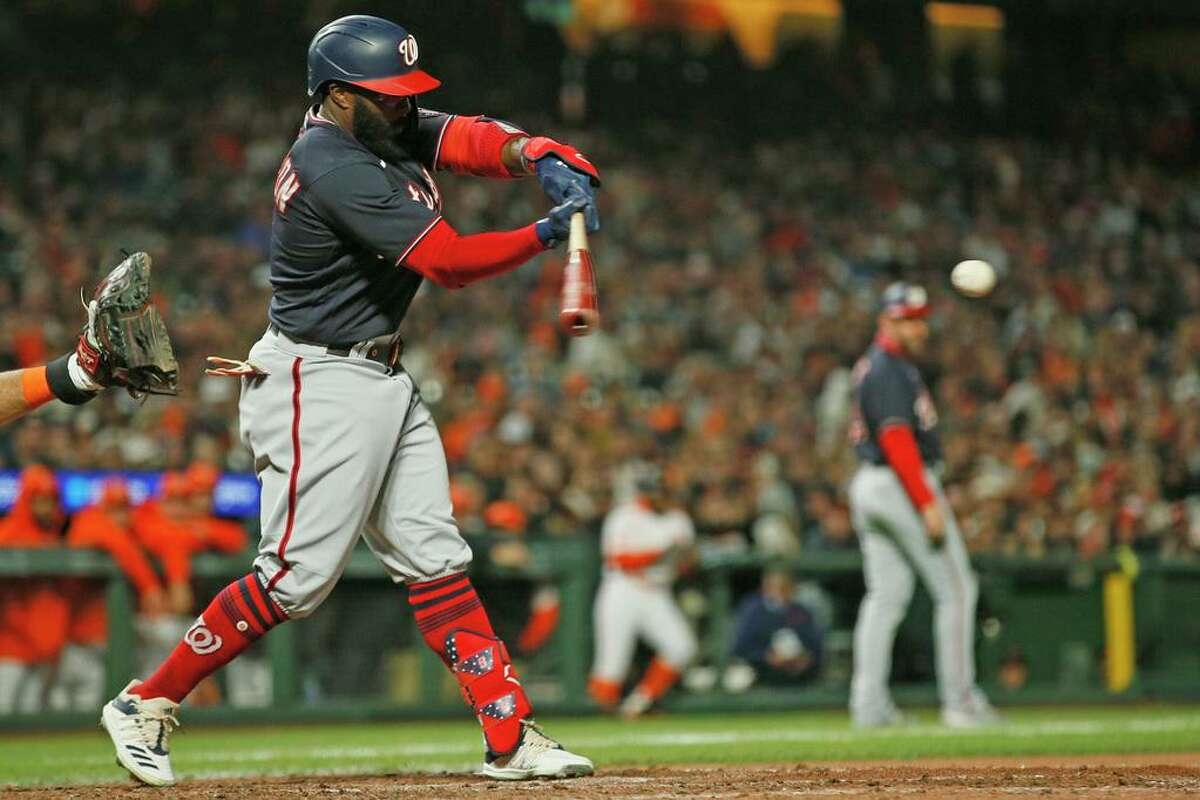 Washington Nationals Josh Harrison (5) singles in the eighth inning during an MLB game against the San Francisco Giants at Oracle Park, Friday, July 9, 2021, in San Francisco, Calif.