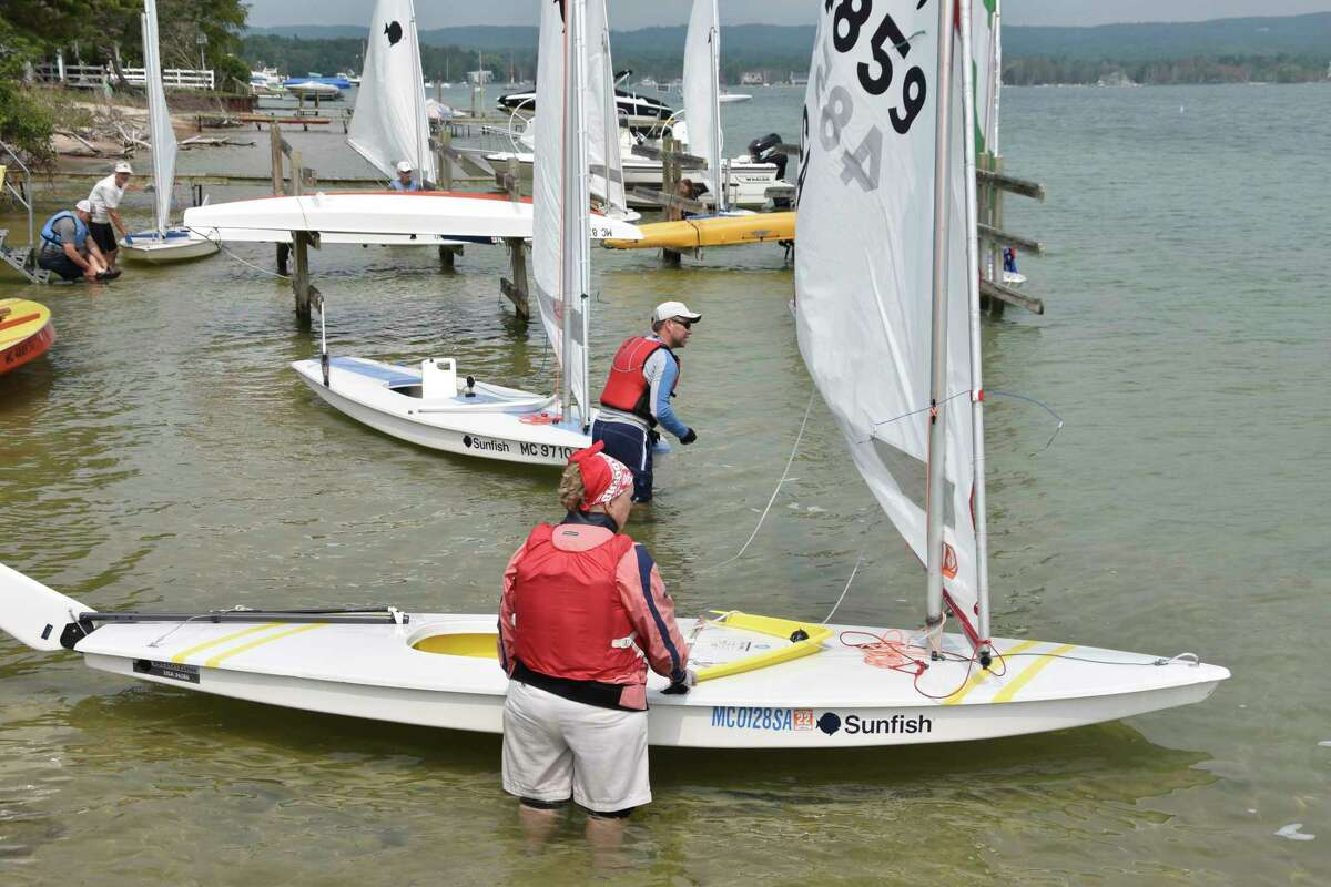 Eleven Sunfish racers ready to set sail around Portage Lake on Saturday afternoon during an event tied to the Onekama's 150th celebrations. (Arielle Breen/News Advocate)