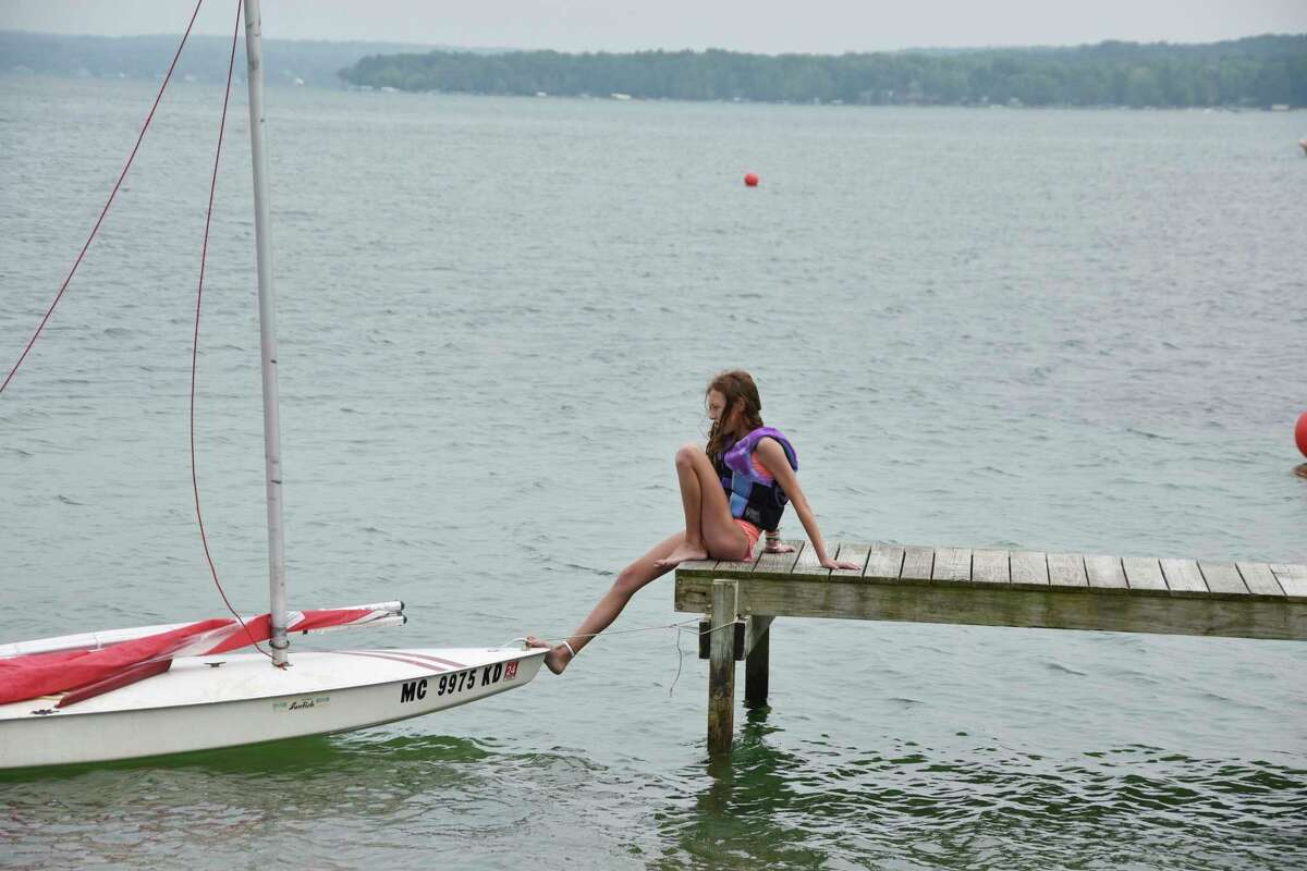 One of the Sunfish participants waits for her racing partner prior tot he start of the race on Saturday at Portage Lake. (Arielle Breen/News Advocate)