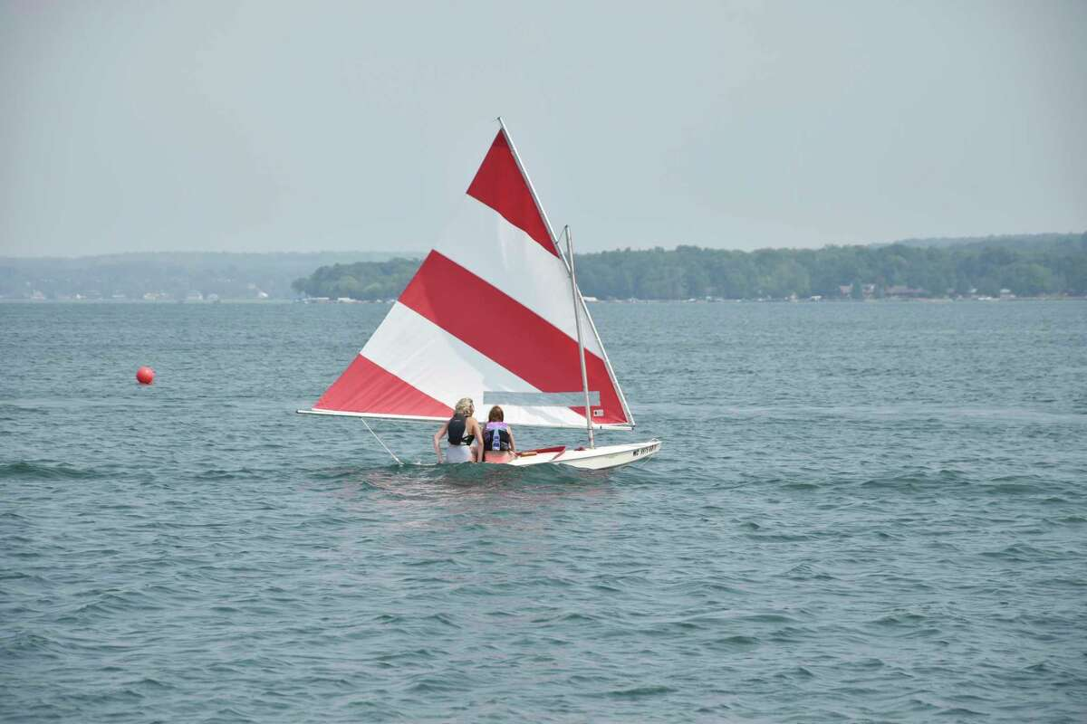 Two young sailors make their way across Portage Lake on Saturday afternoon during the Portage lake Yacht Club Sunfish race. (Arielle Breen/News Advocate)