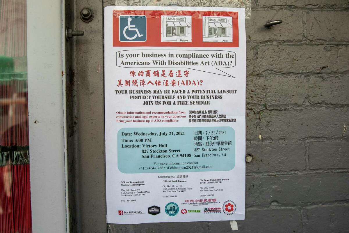A Chinatown poster promotes a free seminar on protecting businesses from frivolous Americans With Disabilities Act compliance lawsuits,