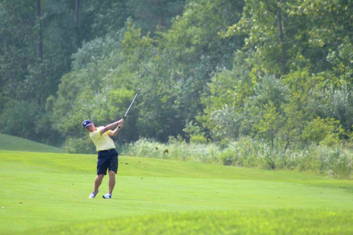 Tim Coffey hits an approach shot during the City Open Championship on Aug. 1 at Currie West Golf Course (Austin Chastain/austin.chastain@hearstnp.com)