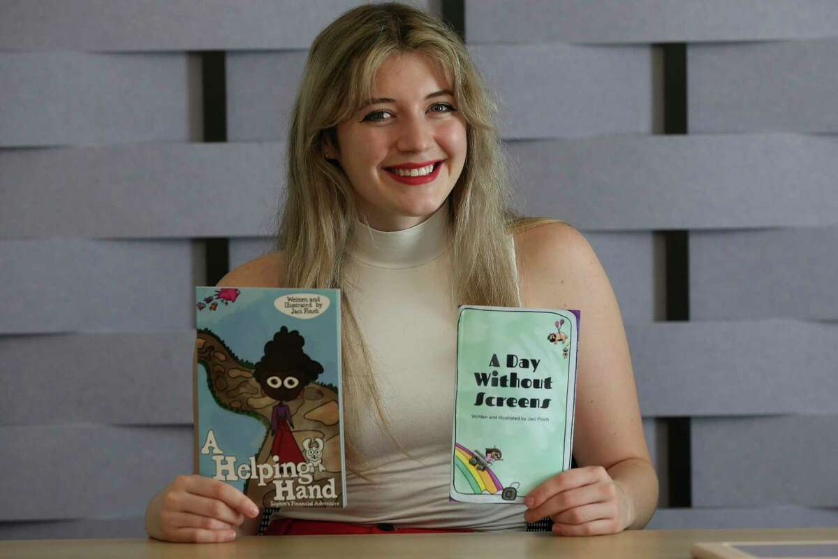 Jaci Finch, 20, is pictured at the Hemisfair offices Wednesday. Finch is a marketing intern with the office and has created a series of children's books. She is junior in the Honors College at UTSA.