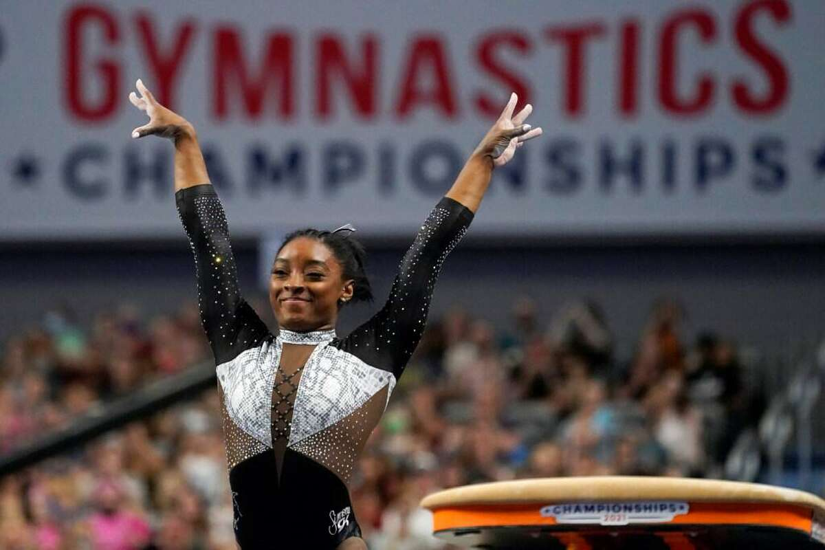 Simone Biles celebrates after competing in the vault during the U.S. Gymnastics Championships in Fort Worth, Texas, in June.