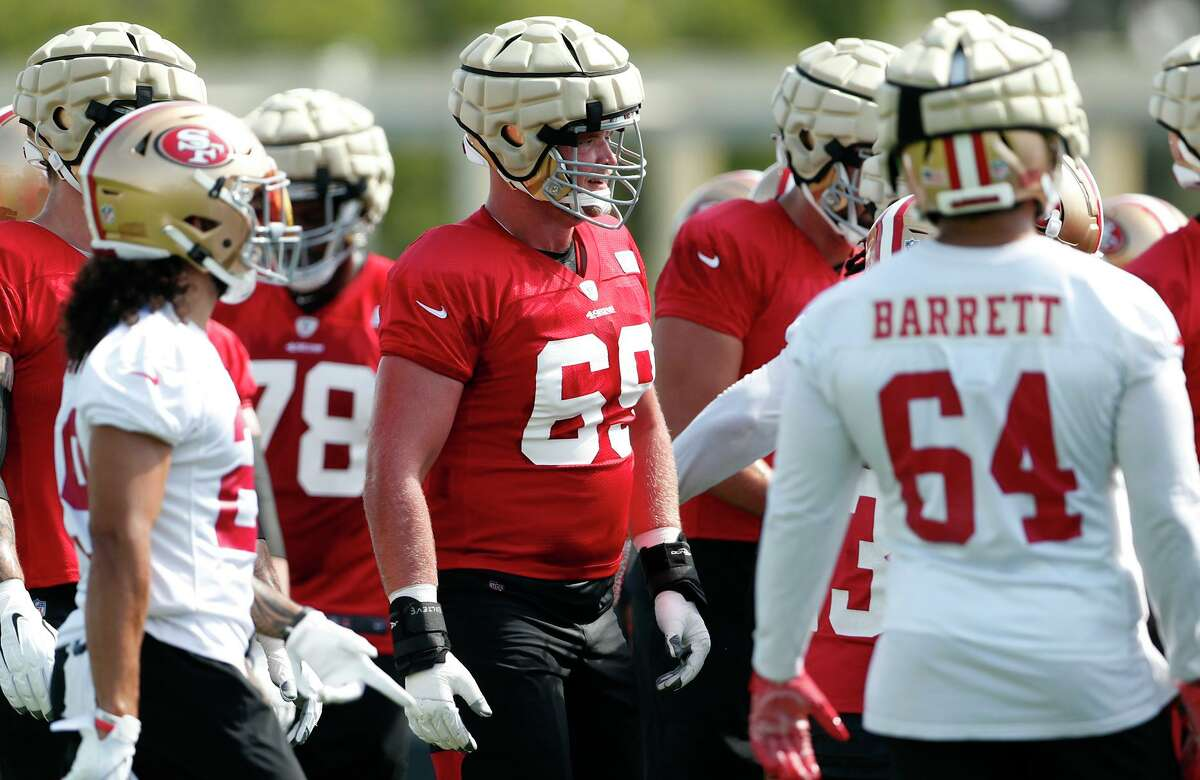The 49ers' Mike McGlinchey (center) during training camp at Levi's Stadium practice field in Santa Clara, Calif., on Wednesday, July 28, 2021.