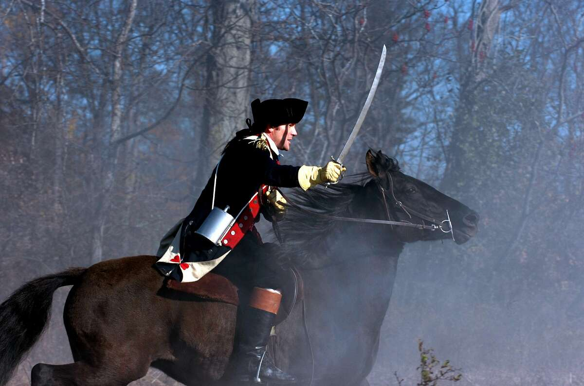"""Peter O'Meara portrays Arnold in the upcoming documentary """"Benedict Arnold: Hero Betrayed,"""" which combines live-action footage of battle re-enactments and commentary by prominent historians. Here, O'Meara as Arnold is shown leading the American assault on enemy lines at the second battle at Saratoga."""