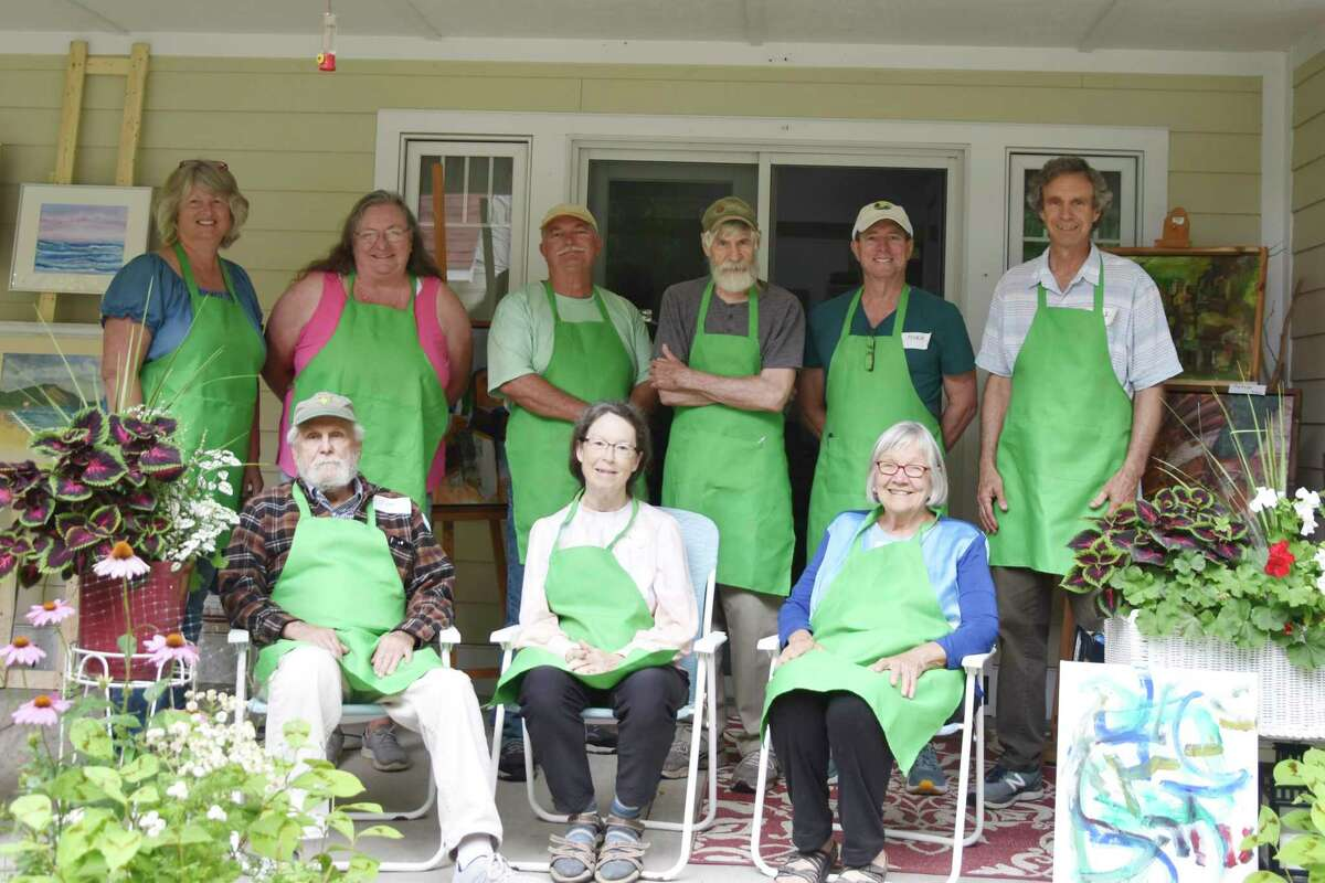 The artists of the Green Apron Art Exhibit and Show are (Front row, from left) Jim Jordan, Ellie Erhard, Carolyn Kraw. (Back row, from left) Beata Hunt, Mary Tebbenhoff, Ed Loftus, David Bedell, Mark Gerson, Paul Erhard. Barbara Carlon and Mariah Pearl are not pictured. (Arielle Breen/News Advocate)