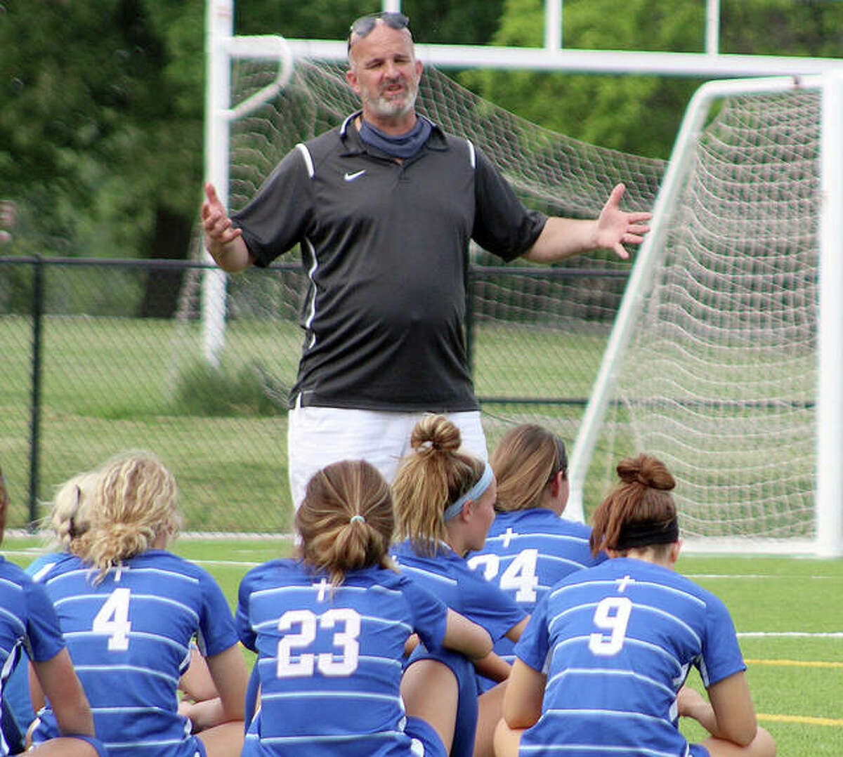 Marquette coach Brian Hoener talks to his team during halftime of a 2021 game against Roxana at Gordon Moore Park.