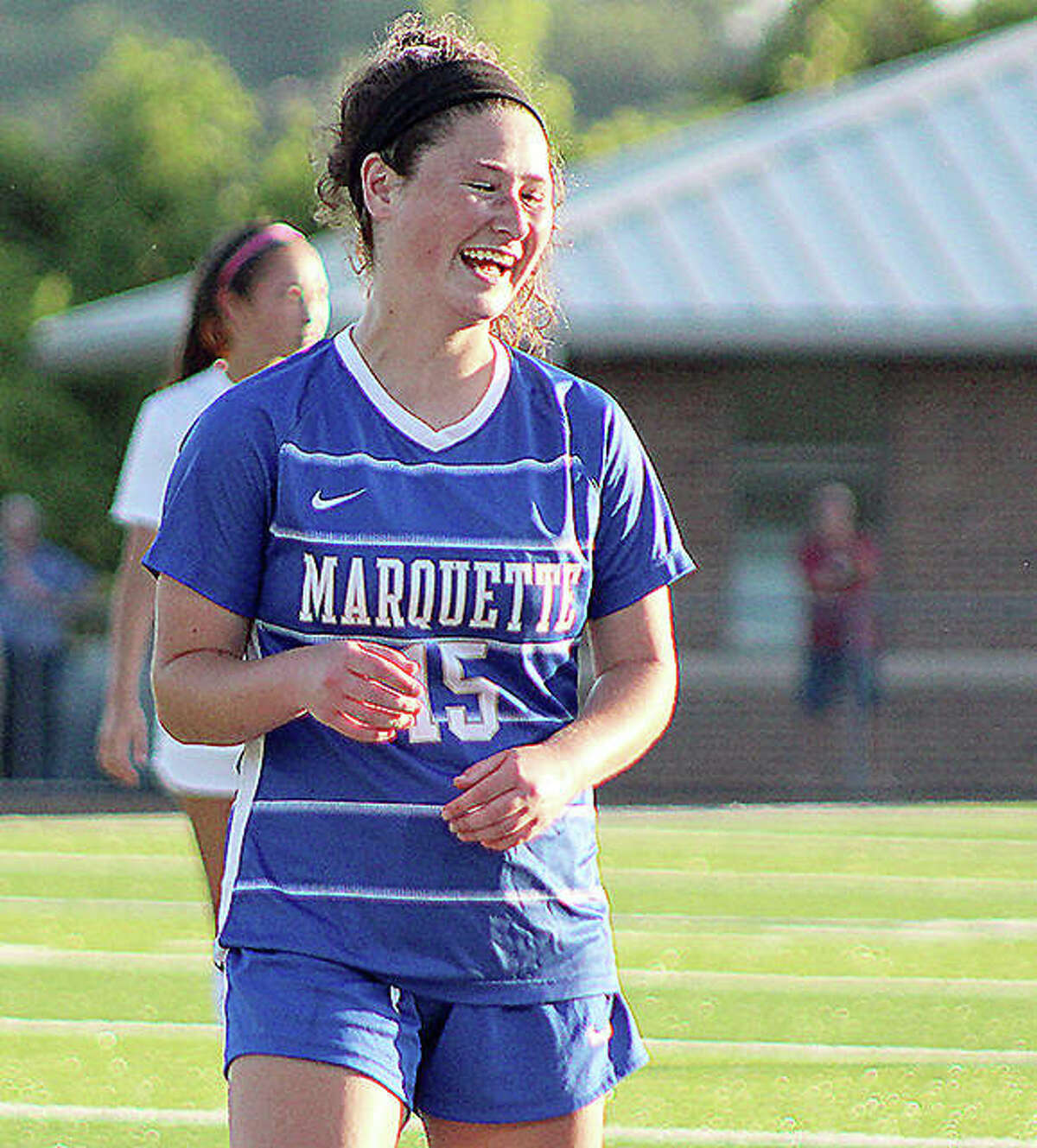 Marquette's Madelyn Smith shares a laugh with a teammate during a 2021 game at Gordon Moore Park.