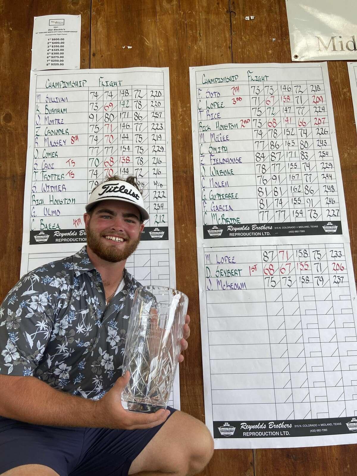 Davis Seybert holds the glass vase trophy after winning the Star Electric Midland Men's City Championship, Aug. 1 at Hogan Park Golf Course.