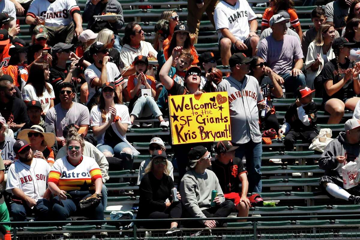 A San Francisco Giants' fan in left field bleachers welcomes Kris Bryant to the team before Giants play Houston Astros in MLB game at Oracle Park in San Francisco, Calif., on Sunday, August 1, 2021.