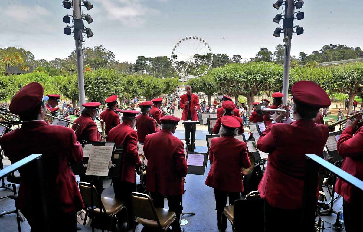 Bob Calonico leads the Golden Gate Park Band in San Francisco as performers return for free summer concerts after a pandemic absence.