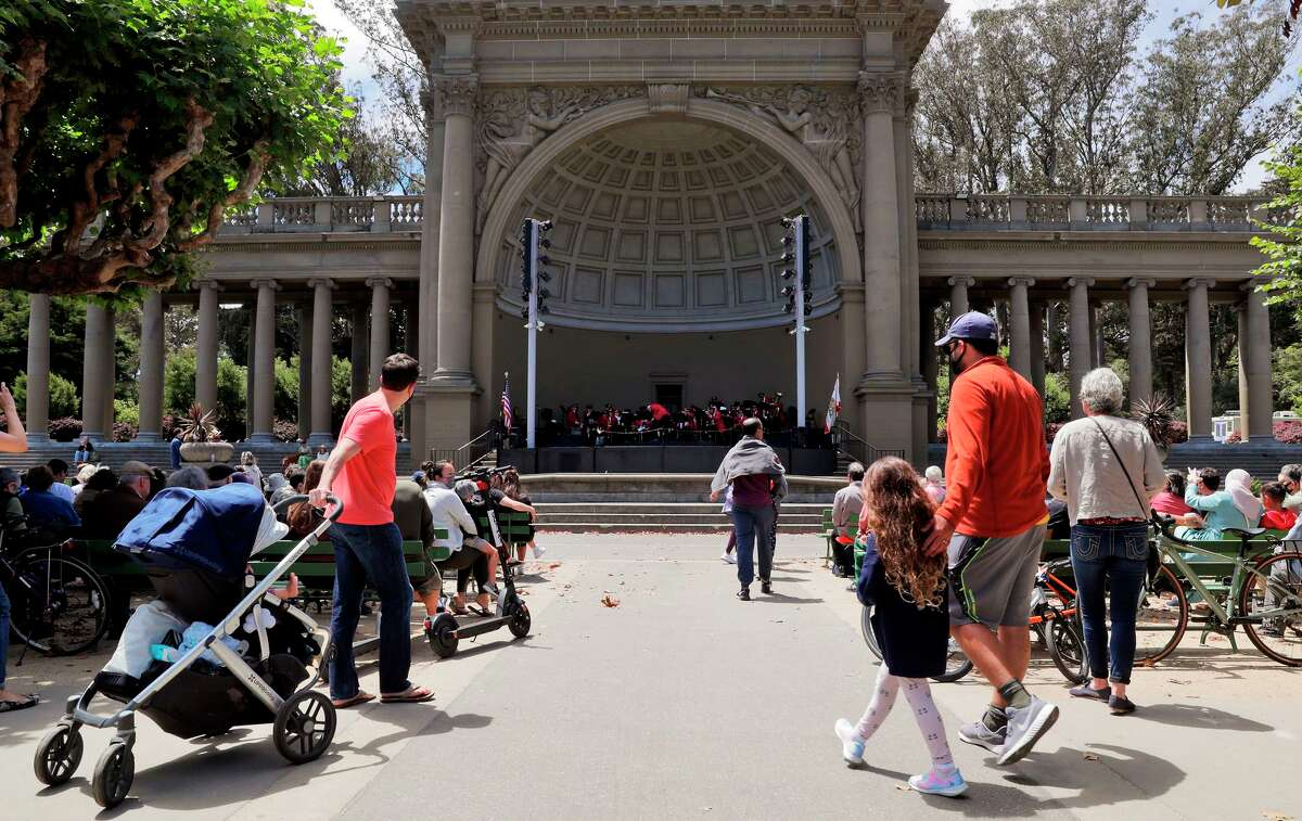 Visitors walk to their seats as the Golden Gate Park Band plays in San Francisco.