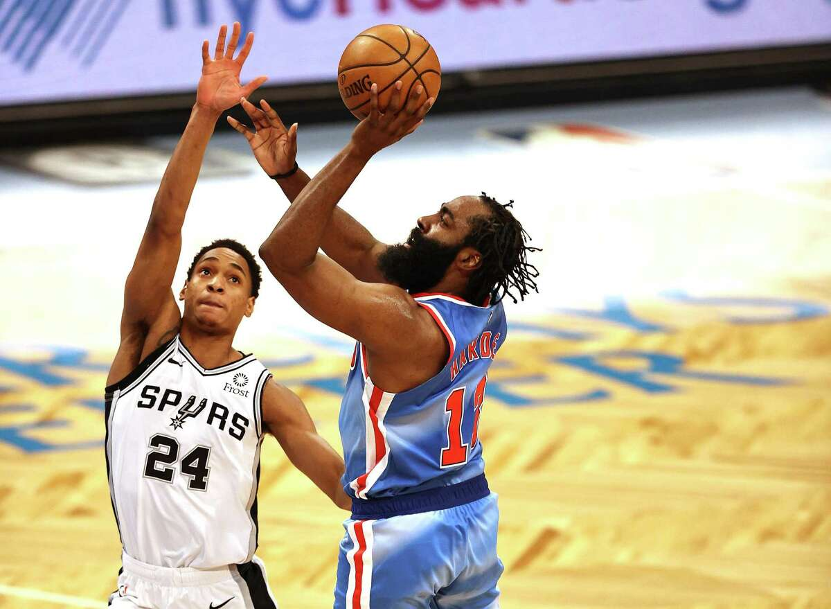 Swingman Devin Vassell (24), guarding the Nets' James Harden, will begin his second season with the Spurs playing in the NBA summer leagues in Salt Lake City and Las Vegas.