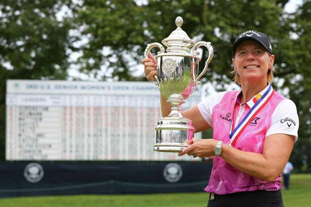 Annika Sorenstam holds up the trophy after winning the 2021 U.S. Senior Women's Open at Brooklawn Country Club on Sunday in Fairfield.