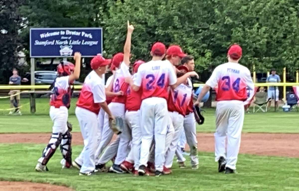 Manchester celebrates a state title win in the Little League State Championship 10-0 over Wilton