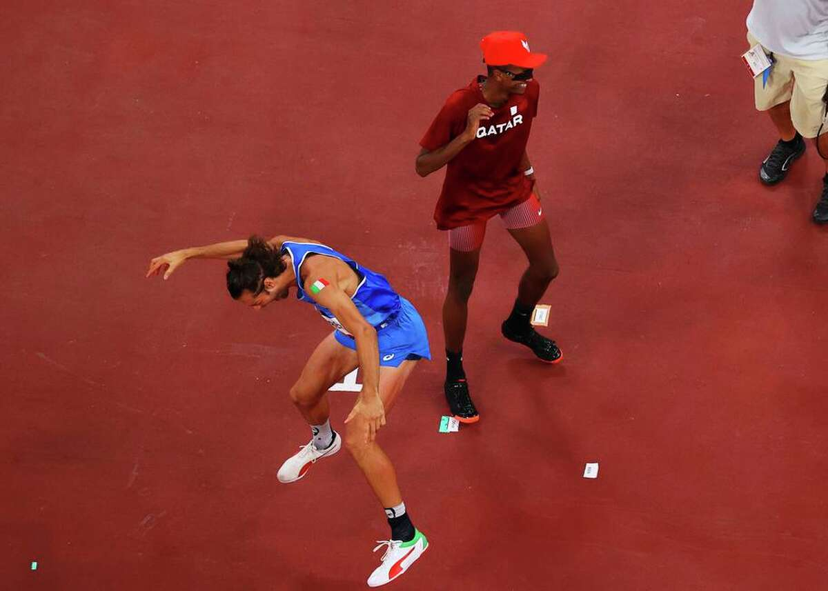 Friends Gianmarco Tamberi of Italy and Mutaz Essa Barshim of Qatar exult after sharing the gold medal in the high jump.