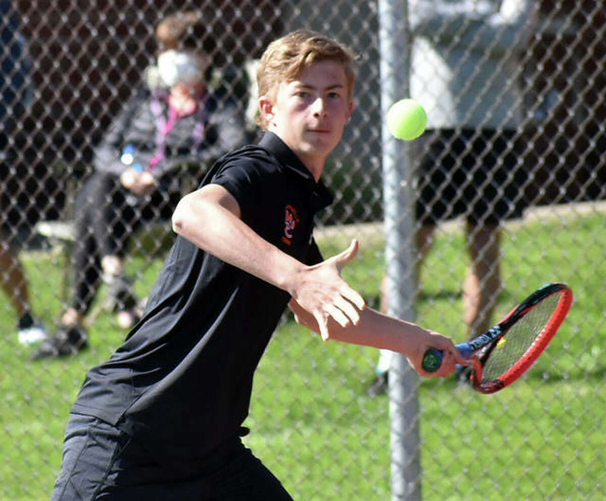 Edwardsville's Colton Hulme hits a forehand shot during his doubles match on April 13 against Belleville East inside the EHS Tennis Center.