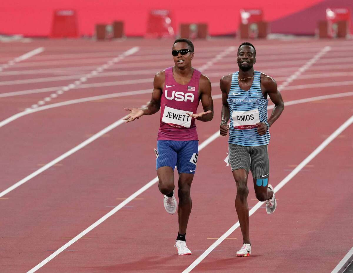 Isaiah Jewett of Team USA and Nijel Amos of Team Botswana jog to the finish after falling in their semifinal heat of the men's 800 meters.